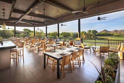 Grill deck.  Perfect setting for outdoor dinning with spectacular views of both the 18th hole of our Boulders North Course and Boulders South Course.