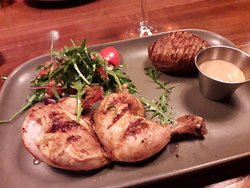 Half a chicken with hasselback spud and a side salad