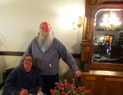 Ilona and Gary (he looks like a Santa cousin, but he is ALL BISBEE)