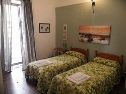 Gelsomino, camera doppia con bagno in comune con un'altra stanza.