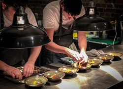Watch as the chefs cook & prepare your dishes