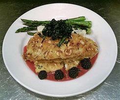 Hazelnut Crusted Petrale Sole Served with a Marionberry Chambord beurre blanc, mashed potatoes and hardwood grilled asparagus.