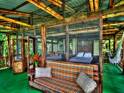 Master bedroom at the Beach House. Beach behind and jungle everywhere else!