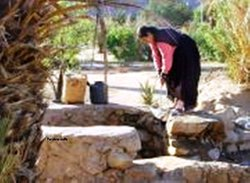 Amazigh girl brings water from well