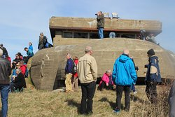 Tourists visiting one of the many still remaining Bunkers