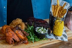 Slow-smoked Mama's Ribs, spicy Frank's Buffalo Chicken Wings and crispy Battered Shrimp