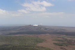 Helicopter view of the volcano steam vent
