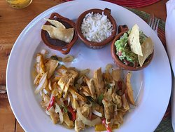 Chicken fajitas with guacamole, rice and re-fried beans