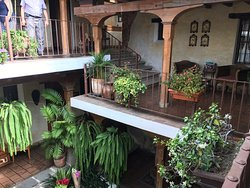 A comfortable room with views of the courtyard from the balcony