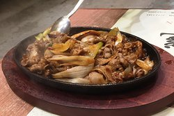This is sliced beef with spring onion served on sizzling iron plate.  You hear and smell and everybody is watching as it comes you way.  We also offer sliced mutton as an alternative.