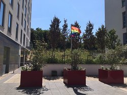 Pride flag being flown outside hotel during summer 2019