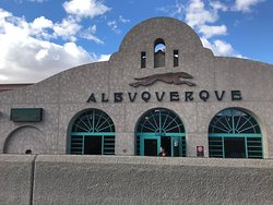 View of Albuquerque's Alvarado Travel Center from the train tracks side.  A long wall separates the buildings from the train tracks.  December 2018.
