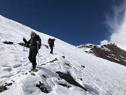 Descending the pass after a snow storm. Poles a good idea.