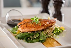Honey Glazed Salmon Salad Served on raw baby spinach & rocca with quinoa, drizzled with tangy yuzu dressing.