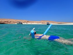 Using a pool noodle helps those new to snorkeling