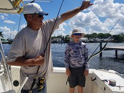 Captain Brook patiently helps my nephew with a Pin Fish he caught.