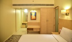 Our suite room. Largest in the area with a hall and 2 toilets. corporate travelers will appreciate our work desks in every room and high connectivity Wi-Fi. Vacationing families here in Pune can enjoy the affordable luxury of our well-appointed 117 Rooms.