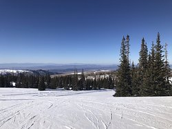 top of Navajo Peak and at bottom past the trees is ski lift across from Cedar Breaks Lodge parking lot