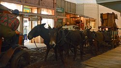 Mule Drawn Wagon in the Muddy Boomtown, USA city street