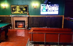 A COMFORTABLE SETTING UPSTAIRS WITH BILLIARDS, DARTS, AND YOUR OWN BAR