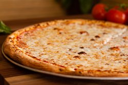 Our glorious Cheese Pizza on our natural Vegan crust.  We use part-skim mozzarella cheese that has a fresh taste, not oily like some others.