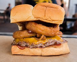 RINGER – cheddar cheese, smoked bacon, onion rings, bbq sauce