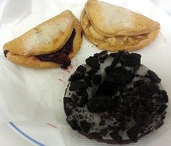 cherry turnover, apple turnover and an Oreo frosted donut