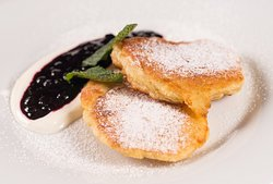 Buttermilk pancakes with blueberry sauce and sour cream