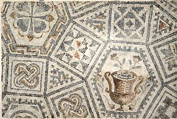Mosaics adorned countless Roman homes, mostly in cities and countryside villas, as well as public buildings. The photo shows part of the mosaic floor from Emona.