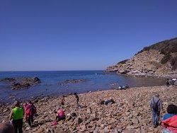 "The pebble beach of the ""Cala""."