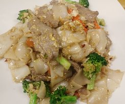 Pad See Ew is a lighter version of our Pad Kee Mao dish. A real treat for those who love noodle dishes! Call (509) 888-8188 to place a takeout order!