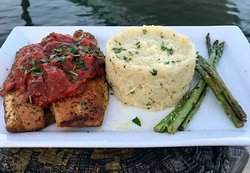 Mediterranean Seabass filet topped with a classic poutanesca sauce, creamy risotto and asparagus.