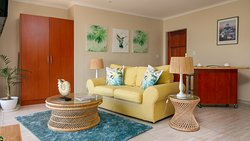 Le Palmier Apartment 4 Living room area overlooking False Bay and Helderberg mountain range