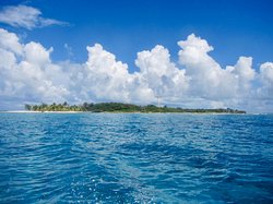 Approaching Glover's Reef Atoll