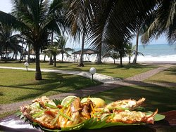 grilled seafood lunch on the porch of your suite