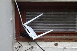 This Wi-Fi hub was installed outside in the hope of boosting the room's Wi-Fi reception.