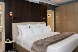 The private bedroom in the Presidential Suite features a wall to wall custom made wardrobe.