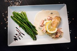Walleye fish with capers and asparagus.