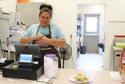 A Shoshone cashier presents our taco