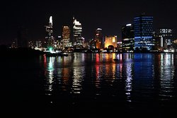 Along the Saigon River at night.