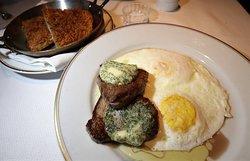 Filet mignon, beurre maître d'hôtel (filet mignon, maitre d' butter, over easy eggs) with an optional Pomme Darphin (potato pancake)
