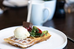 Belgian waffle, served with fresh fruit, ice cream and of course a hot chocolate drink.