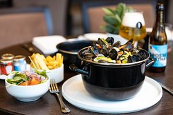 A typical Belgian dish: mussels with French fries, salad and paired with a Brussels Beer project beer.