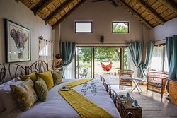 Ndlovu Chalet bedroom and outside veranda view