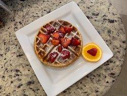 Belgium waffle. Homemade waffle with powdered sugar.