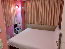 Economy Double Room. View of the room at the entrance.