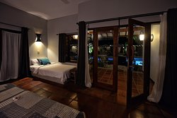 Our twin room configuration with one queen bed and one single bed.