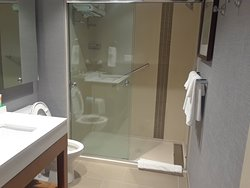 Bathroom is nicely arranged with walk in type shower. Can be easily navigated.