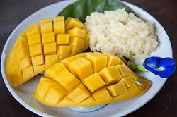 Lao dessert . Mango sticky rice .   cook from the fresh coconut milk .