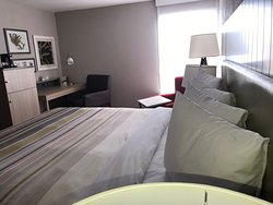 King Room Country Inn & Suites Greenville SC. Work Desk with charging station, WIFI, Microwave, Refrigerator, Coffee/Tea maker, USB Ports and Electrical Outlets conveniently placed throughout the room.  King Rooms have and extra chair with movable table.